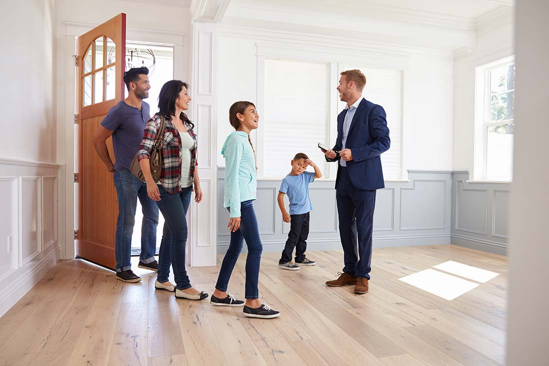Realtor Showing a Family Around New Home after a thorough inspection by home inspector